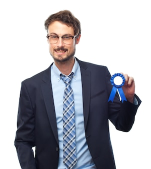 Happy man with a blue medal