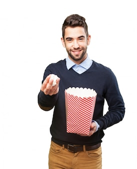 Happy man with popcorn Free Photo