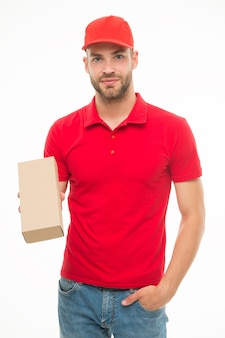 Happy man with post package isolated white. delivering your purchase. gifts for holidays. courier service delivery. salesman and courier career. courier and delivery service. postman delivery worker.