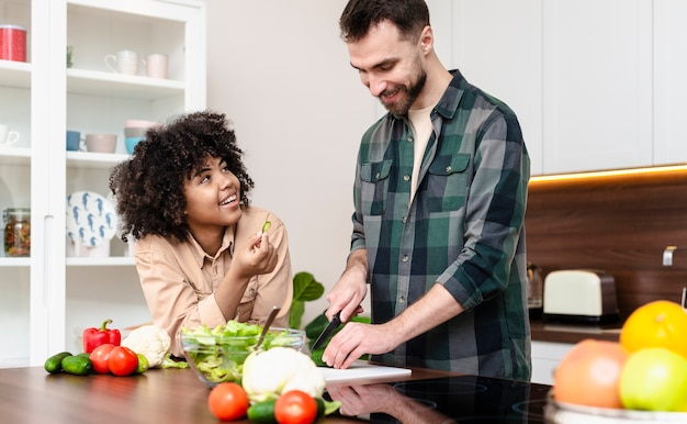 Happy man and woman cooking together