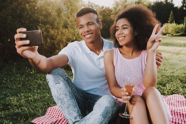 Happy man and woman is doing selfie on cellphone