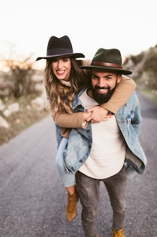 Happy man and woman looking at photographer