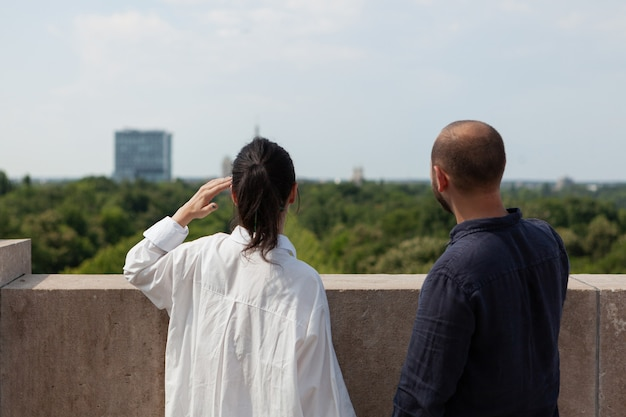 Happy married couple looking at metropolitan city view