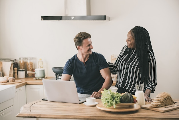 Happy married interracial couple at home in the morning