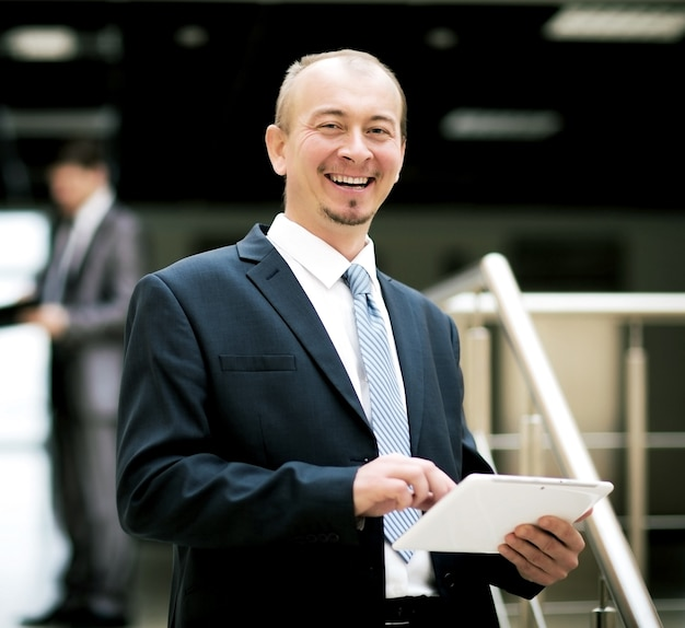 Happy mature business man looking at camera with satisfaction office