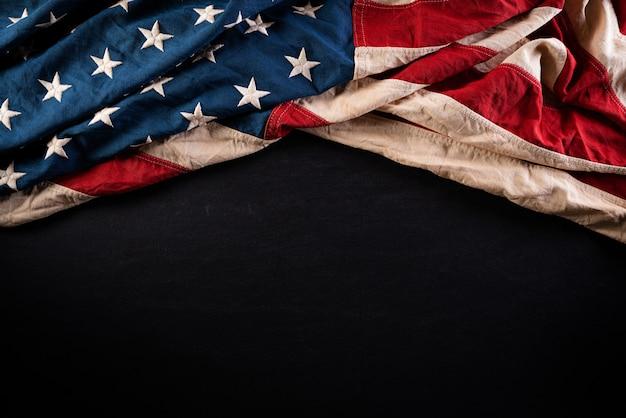 Happy memorial day. american flags against a blackboard wall