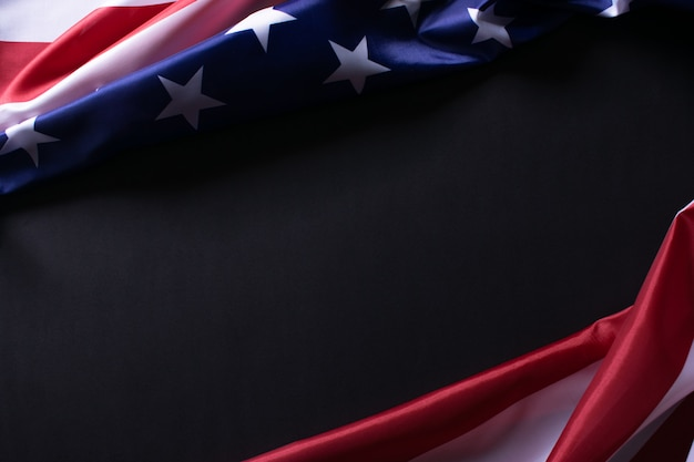 Happy memorial day or independence day.  american flags against a black paper background.