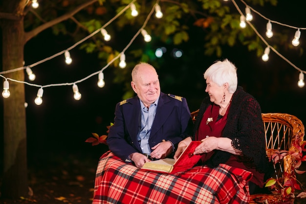Happy memories. happy senior couple sitting on sofa watching album with photos.