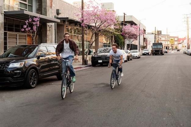 Happy men riding bicycles in city