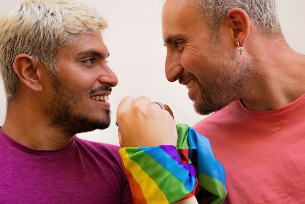 Happy men united with lgbt flag