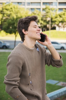 Happy mid adult man talking on cell phone