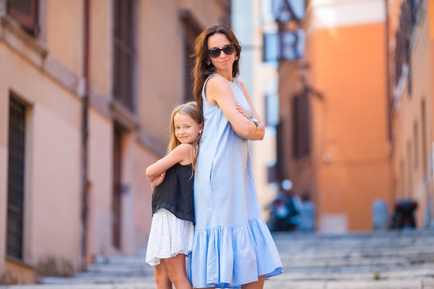 Happy mom and little adorable girl traveling in rome, italy