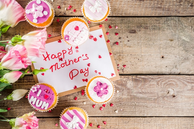 Happy moms day background with cupcakes