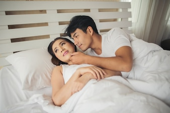 Happy morning couple in the bed