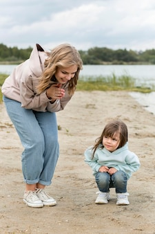Happy mother and child on sand
