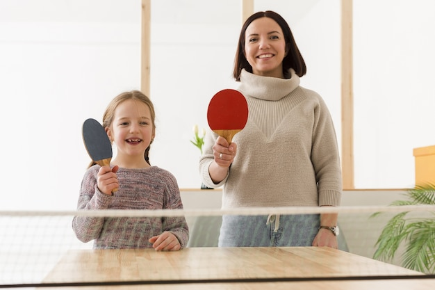 Happy mother and daughter playing sports