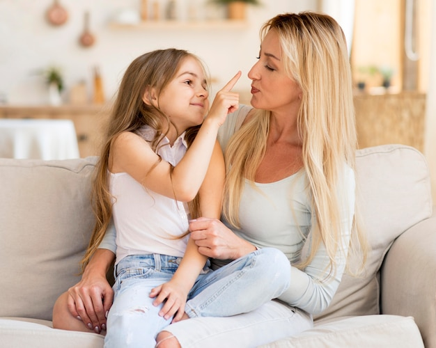 Happy mother and daughter spending time together at home