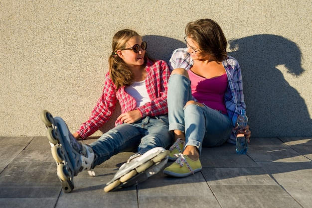 Happy mother and daughter talking outdoors