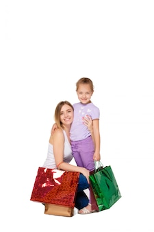 Happy a mother and daughter with shopping bags