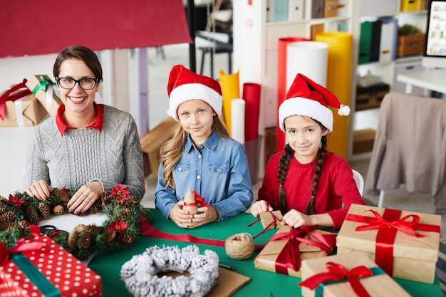 Happy mother and daughters with christmas presents