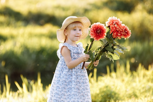Happy mother's day. child daughter congratulates mom and gives her a bouquet of flowers outdoors.