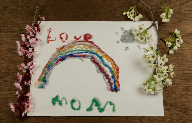 Happy mother's day concept - i love mother sign over white wood background children's drawing