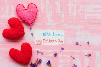 Happy mother's day concept on bright pink pastel wooden background.
