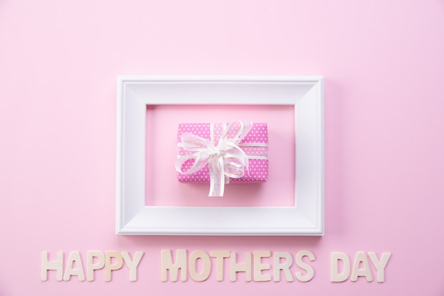 Happy mother's day concept. top view of picture frame and gift box