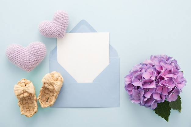 Happy mother's day greeting card, hearts, lilac flower on blue. mock up.