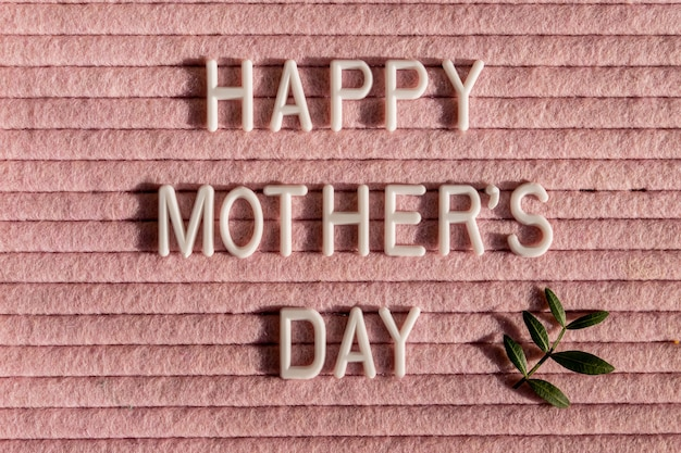 Happy mother's day letter board and green leaves. mother's day greting card.