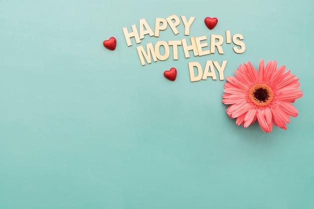 «счастливый день матери» надпись с цветком
