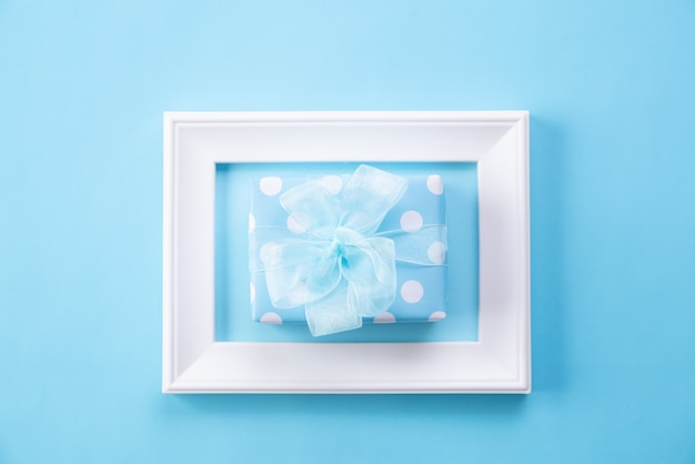 Happy mother's day with top view of picture frame and gift box