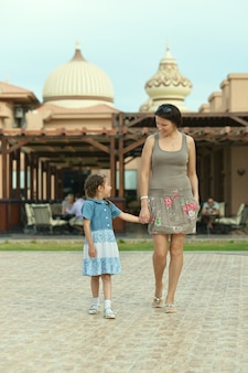 Happy mother with her daughter in summer park