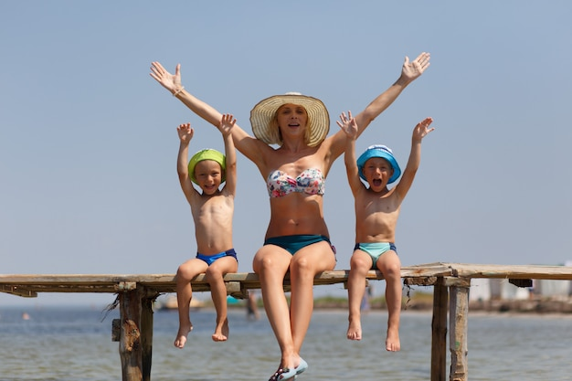 Happy mother with two sons twins
