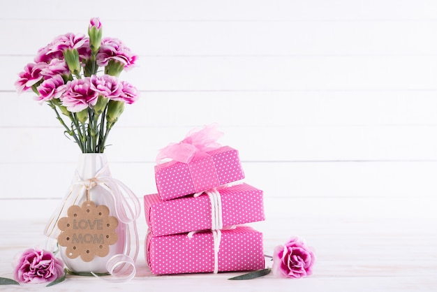 Happy mothers day concept. gift box with pink carnation flower