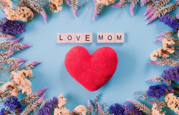 幸せな母親の日コンセプトパステル青い背景。