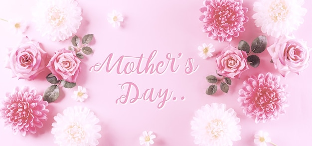 Happy mothers day concept vintage style of pink roses and beautiful flower frame on pastel background
