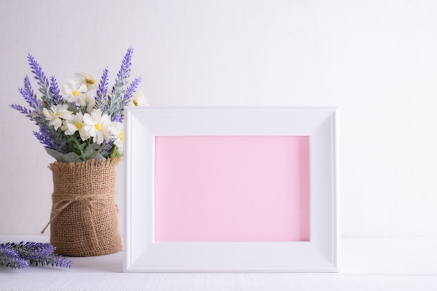 Happy mothers day concept. white picture frame with lovely purple flower
