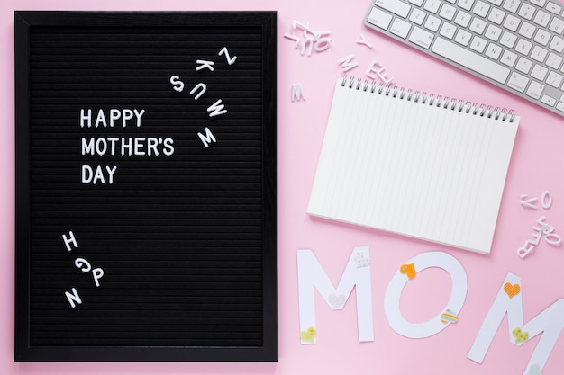 Happy mothers day inscription on board with notebook