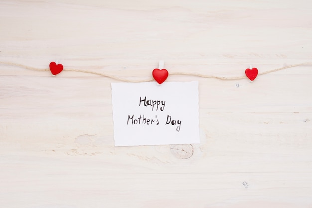 Happy mothers day inscription pinned to rope