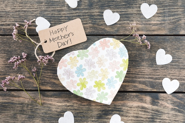 Happy mothers day inscription with flowers an paper hearts