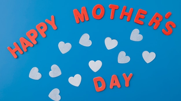 Happy mothers day inscription with hearts