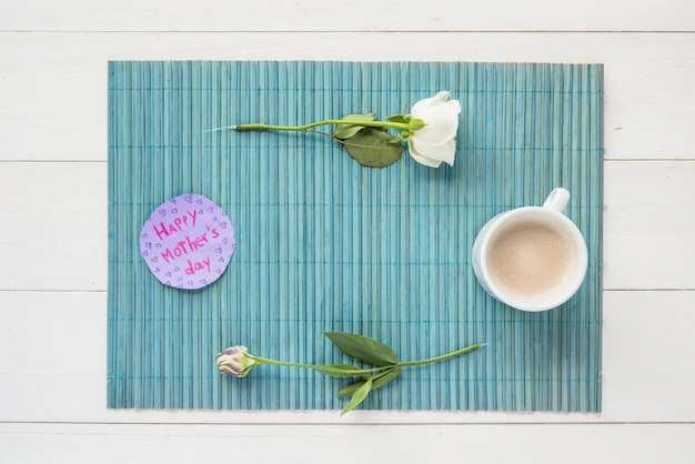Happy mothers day inscription with roses and coffee cup