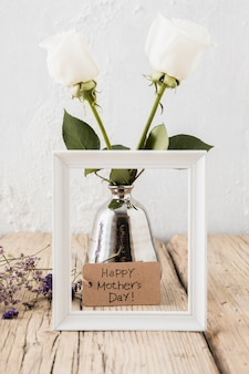 Happy mothers day inscription with roses in vase
