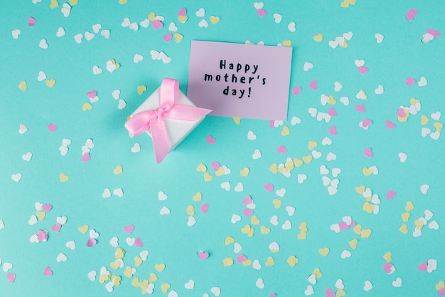 Happy mothers day inscription with small gift box