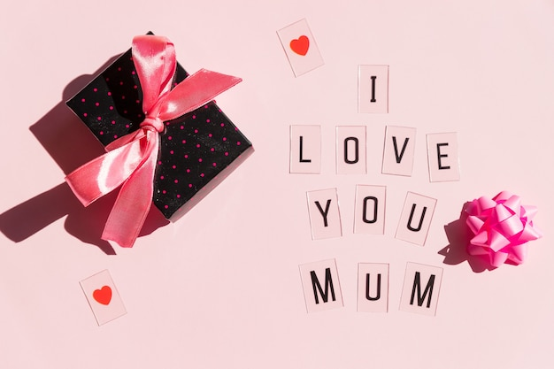 Happy mothers day message with red hearts on bright pink background.greeting card concept. mothers day message.gift and text