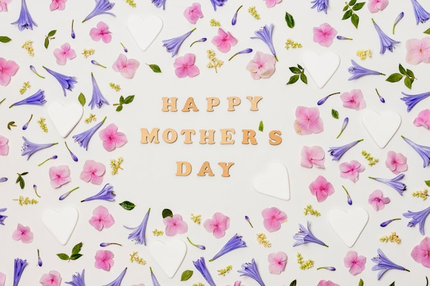 Happy mothers day title between decorative flowers