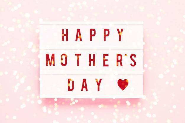 ライトボックスに書かれたhappymothersday。母の日のお祝いのコンセプト。