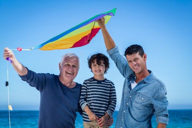 Happy multi generation family playing with a kite