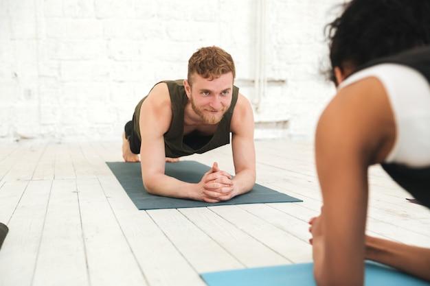 Happy multiethnic people in yoga studio